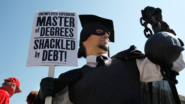 "PHOTO: Gan Golan of Los Angeles, dressed as the ""Master of Degrees,"" holds a ball and chain representing his college loan debt during Occupy DC activities in Washington."