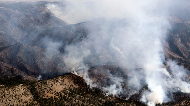 PHOTO: In this aerial photograph, smoke rises from the Lower North Fork Wildfire as it burns near the foothills community of Conifer, Colo., southwest of Denver, March 27, 2012.