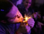 PHOTO: A man smokes marijuana on the official opening night of Club 64, a marijuana-specific social club, where a New Years Eve party was held, in Denver, Dec. 31, 2012.