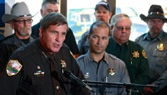 PHOTO: Weld County, Colo., Sheriff John Cooke, left, with El Paso County Sheriff Terry Maketa, center right, and other sheriffs standing behind him, speaks during a news conference at which he announced that 54 Colorado sheriffs are filing a federal civil