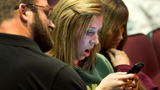 PHOTO: Parent Christy Gorst reacts while reading on her phone a news account detailing the plot by fifth-graders to kill classmates at Fort Colville Elementary School, Feb. 13, 2013 during Colville Schools Security Forum in Colville, Wash.