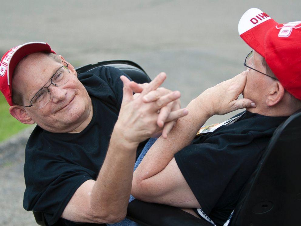 PHOTO: Donnie, left, and Ronnie Galyon, 62, travel inside their wheelchair near their Beavercreek, Ohio, home June 28, 2014.