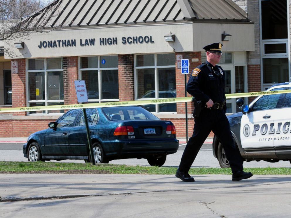 PHOTO: Police remain on scene at Jonathan Law High School after a 16-year-old girl was stabbed to death in Milford, Conn., April 25, 2014.