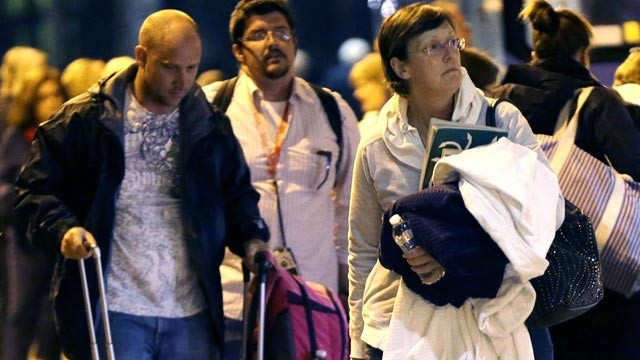 PHOTO: Passengers from the disabled Carnival Triumph cruise ship arrive by bus at the Hilton Riverside Hotel in New Orleans, Feb. 15, 2013.
