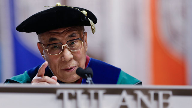 PHOTO: The Dalai Lama speaks at Tulane University's 179th commencement ceremony at the Mercedes-Benz Superdome in New Orleans on Saturday, May 18, 2013.