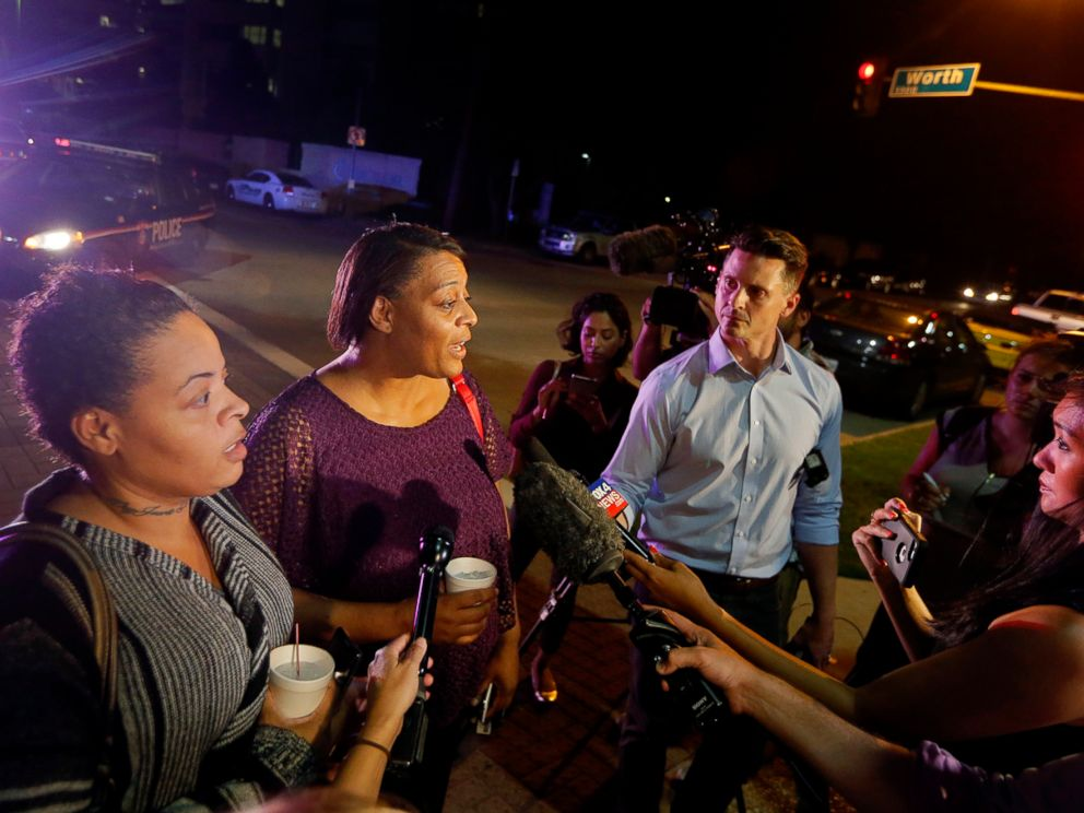 PHOTO: Sherie Williams, left, and Theresa Williams, center, speak to reporters outside Baylor University Medical Center, Friday, July 8, 2016, in Dallas, Texas. Theresa Williams said her sister Shetamia Taylor, was shot in the leg.