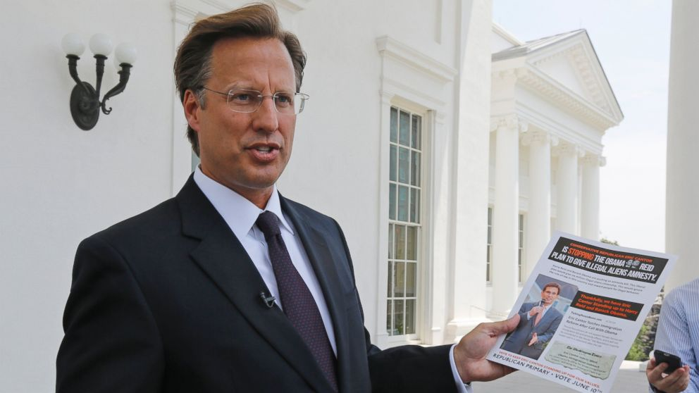 PHOTO: Seventh District US Congressional Republican candidate, David Brat displays an immigration mailer by Congressman Eric Cantor during a press conference at the Capitol in Richmond, Va., in this May 28, 2014 file photo.