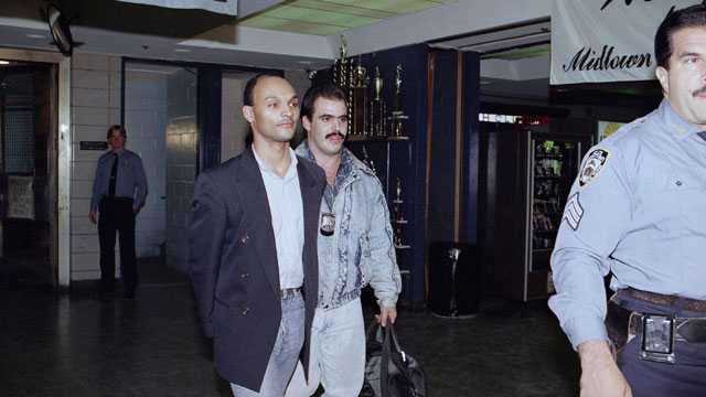 "PHOTO: David Hampton, 27, left, the man who was the subject of John Guare's play ""Six Degrees of Separation"" is led to New York's Midtown South precinct on Nov.6, 1991 after being arrested for allegedly threatening to shoot another man and claiming to be"