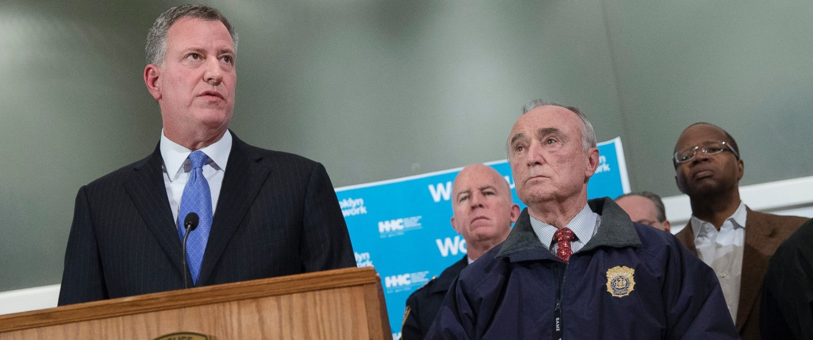 PHOTO: New York City Mayor Bill de Blasio, left, speaks alongside NYPD Commissioner Bill Bratton, right, during a news conference at Woodhull Medical Center, Saturday, Dec. 20, 2014, in New York.