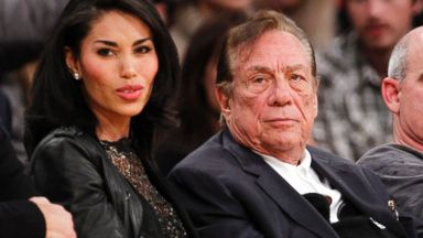 PHOTO: In this Dec. 19, 2010, file photo, Los Angeles Clippers owner Donald Sterling, third right, sits with V. Stiviano, left, as they watch the Clippers play a game in Los Angeles.