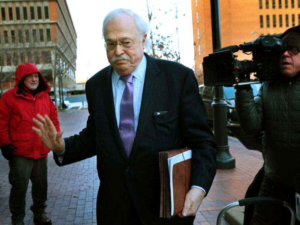 PHOTO: Pathologist Dr. Michael Baden waves off media questions as he arrives to testify before the grand jury concerning the Michael Brown shooting at the Buzz Westfall Justice Center in Clayton, Mo., on Nov. 13, 2014.
