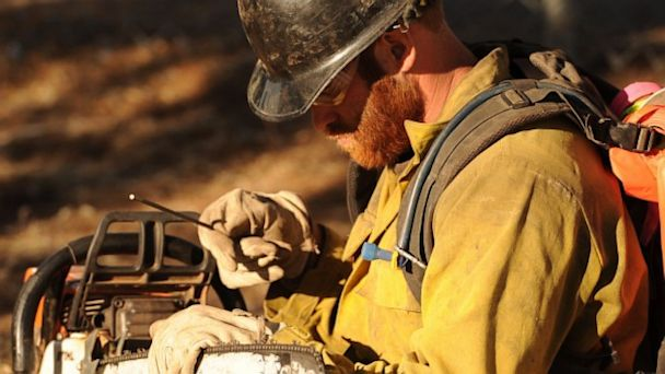 PHOTO: In this June 2013 photo provided by the Prescott Fire Department via the Prescott Daily Courier, Dustin Deford, a member of the Prescott Fire Department Granite Mountain Hotshots, sharpens his chainsaw while working a fire near Prescott, Ariz. DeFo