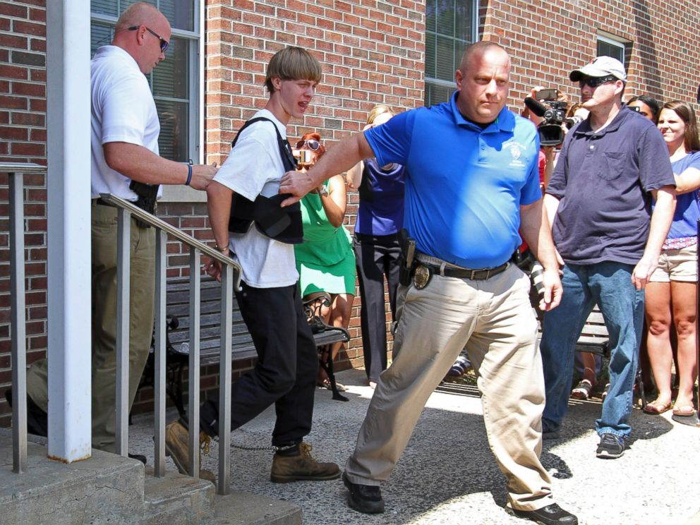 PHOTO: Charleston, S.C., shooting suspect Dylann Storm Roof, second from left, is escorted from the Shelby Police Department in Shelby, N.C., June 18, 2015.