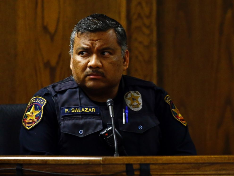 PHOTO: Lancaster police officer Flavio Salazar listens to a question from the defense during the capital murder trial of former Marine Cpl. Eddie Ray Routh in Stephenville, Texas on Feb. 17, 2015.