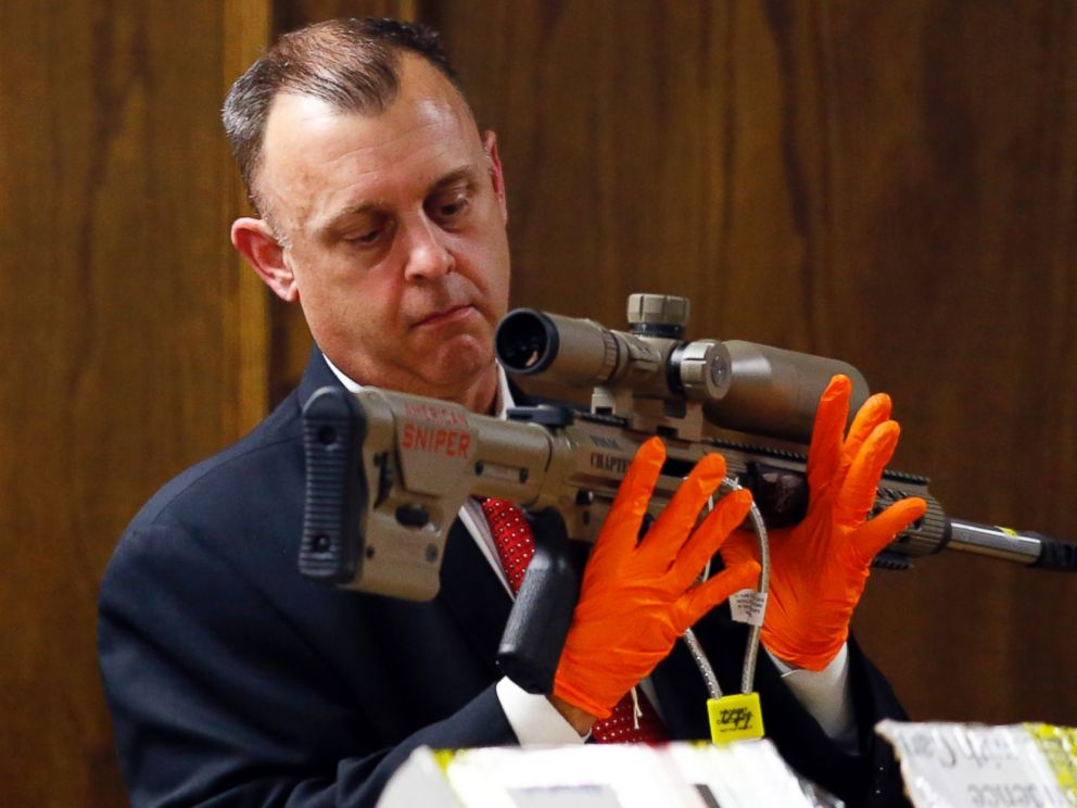 PHOTO: Texas Ranger Michael Adcock holds a rifle with the lettering American Sniper marked on the side during the capital murder trial of former Marine Cpl. Eddie Ray Routh in Stephenville, Texas on Feb. 17, 2015.