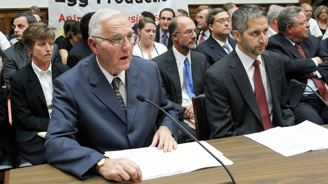 PHOTO: In this Sept. 22, 2010, file photo protestors unfurl a banner on Capitol Hill in Washington as Wright County Egg owner Austin DeCoster, left, testifies  before the House Oversight and Investigations subcommittee hearing on the outbreak of salmonell