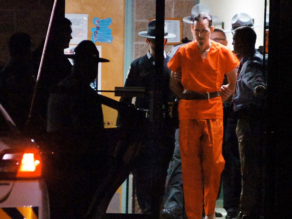 PHOTO: Pennsylvania State Police Troopers take away suspected killer Eric Frein from the Blooming Grove State Police barracks, Oct. 31, 2014, in Blooming Grove Township, Pennsylvania.