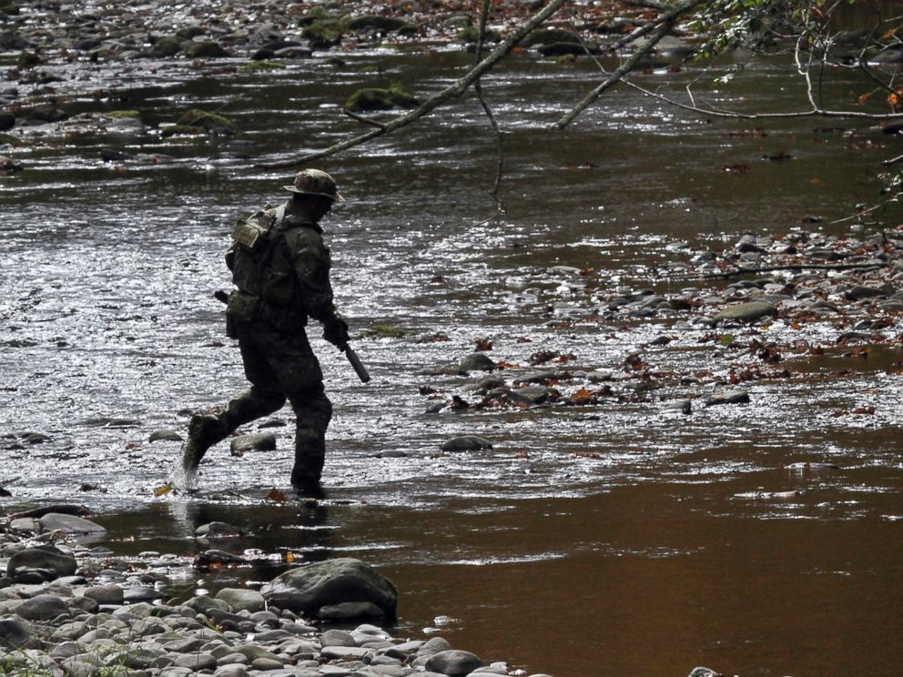 PHOTO: A U.S. Marshal patrols along Mill Creek in Barrett Township, Pa., on Sept 29, 2014.