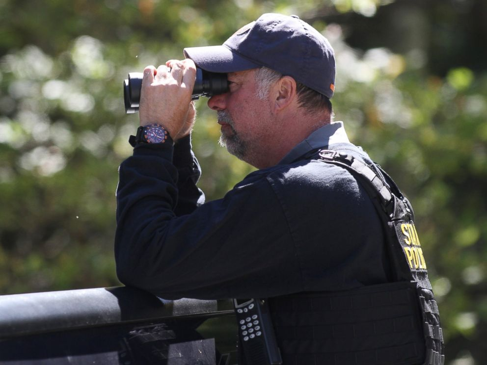 PHOTO: A Pennsylvania State Police trooper helps create a perimeter in the search area for Eric Frien near the intersection of in Canadensis, Pa, on Sept 23, 2014.