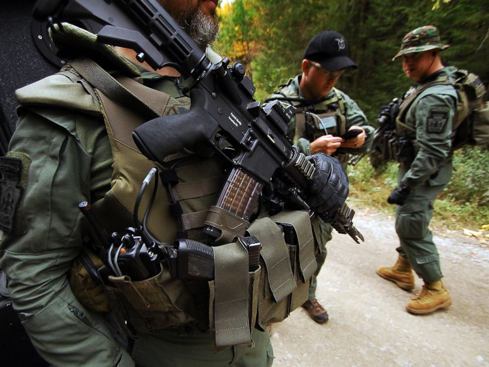 PHOTO: Members of the Scranton Police Special Operations Group prepare to search the woods, Oct. 2, 2014, in Barrett Township near Canadensis, Pa., for suspected killer Eric Frein.