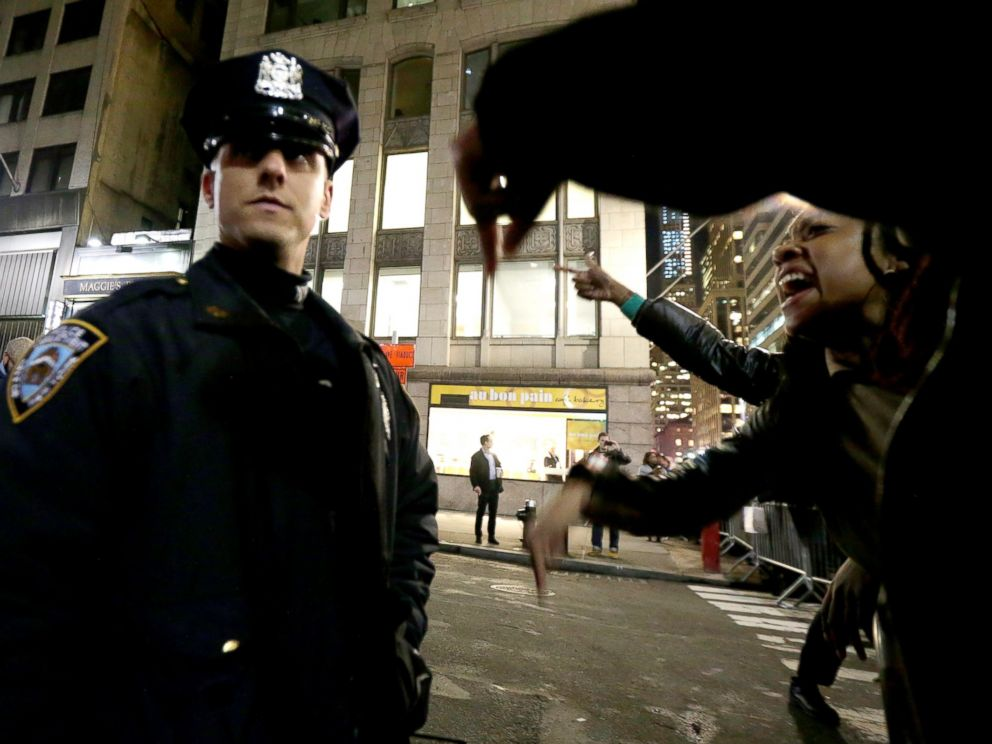PHOTO: A woman yells at a New York City Police officer during a protest after it was announced that the officer involved in the death of Eric Garner is not being indicted, Dec. 3, 2014, in New York.