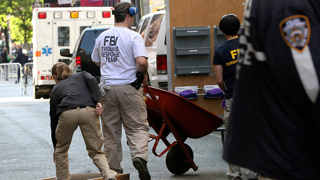 PHOTO: Federal Bureau of Investigation agents move a wheel barrow and a forensic sifting screen from a SoHo basement, April 19, 2012 in New York.