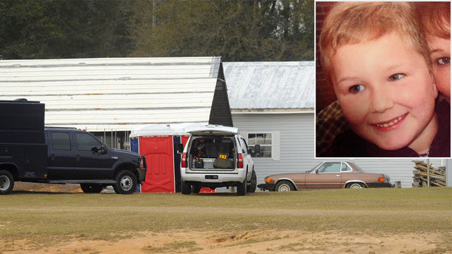PHOTO: Law enforcement personnel station themselves on the property of Jimmy Lee Sykes, Feb. 4, 2013 in Midland City, Ala. Ethan, the 5-year-old boy held hostage in a nearly week-long standoff in Alabama is in good spirits and apparently unharmed.