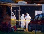 PHOTO: Federal authorities wear hazmat suits as they search the home of Everett Dutschke, April 23, 2013 in Tupelo, Miss., in connection with the recent ricin attacks.