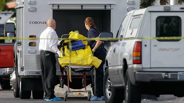 PHOTO: Las Vegas Coroner helps load a gurney holding a homicide victim into the back of a truck on April 16, 2012, in Las Vegas.