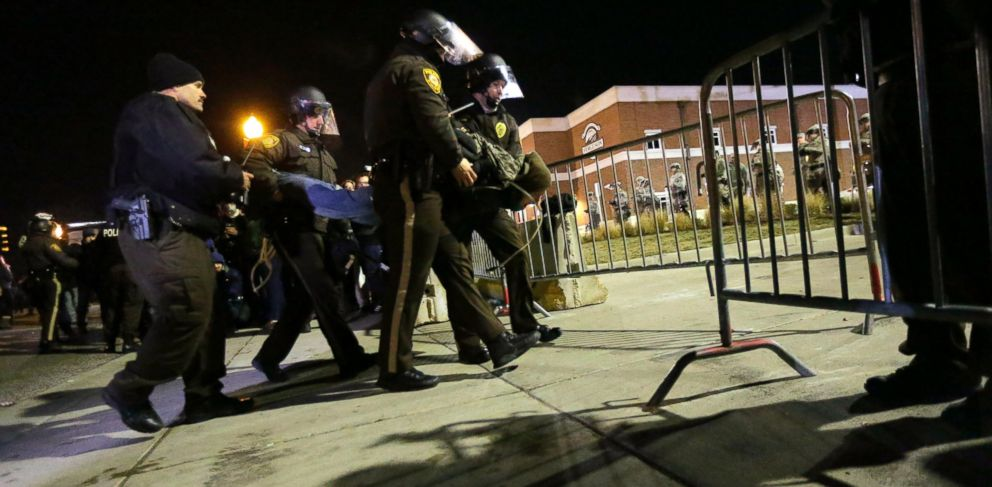 PHOTO: Police take a protester into custody Tuesday, Nov. 25, 2014, in Ferguson, Mo.