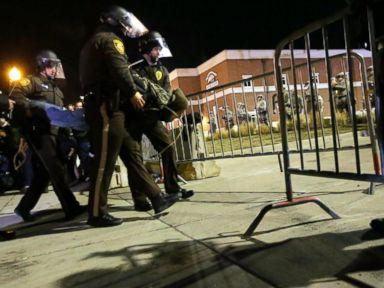 PHOTO: Police take a protester into custody Tuesday, Nov. 25, 2014, in Ferguson, Mo.
