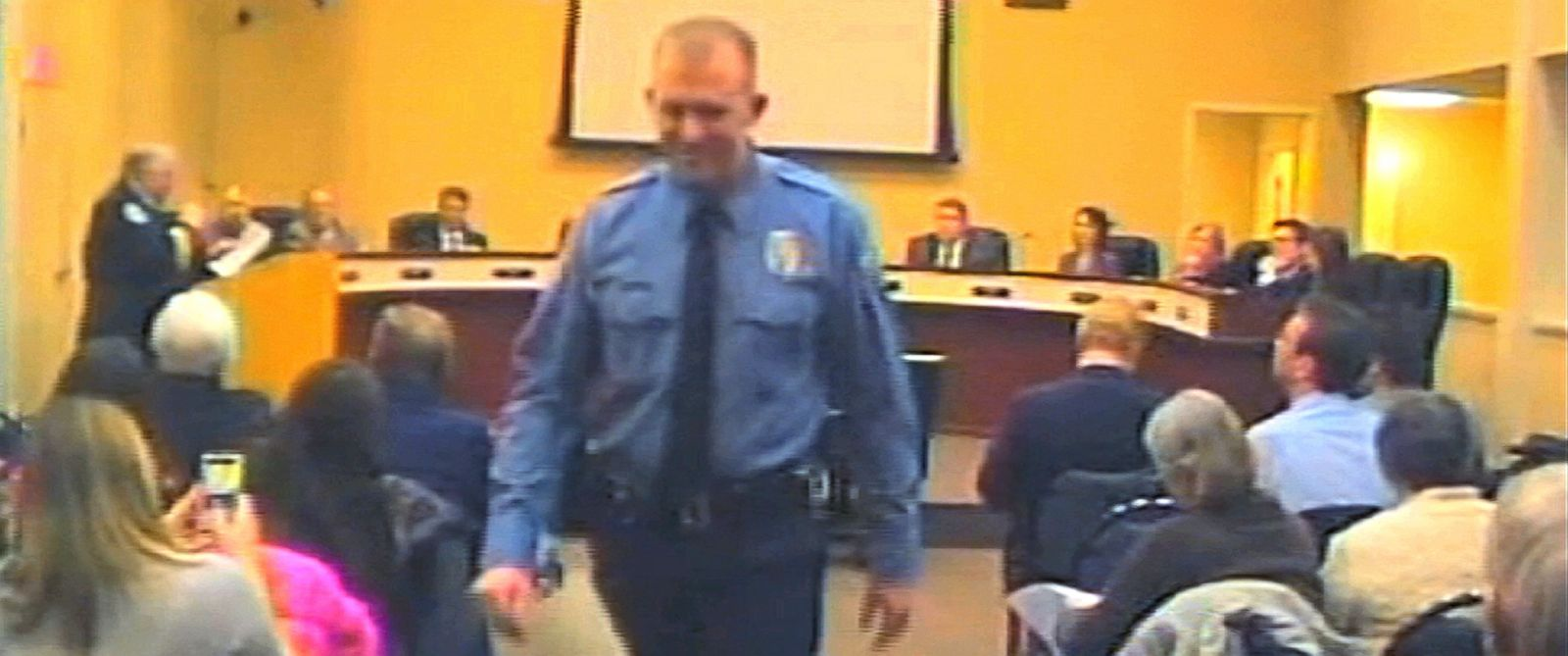 PHOTO: In this Feb. 11, 2014 file image from video provided by the City of Ferguson, Mo., officer Darren Wilson attends a city council meeting in Ferguson.