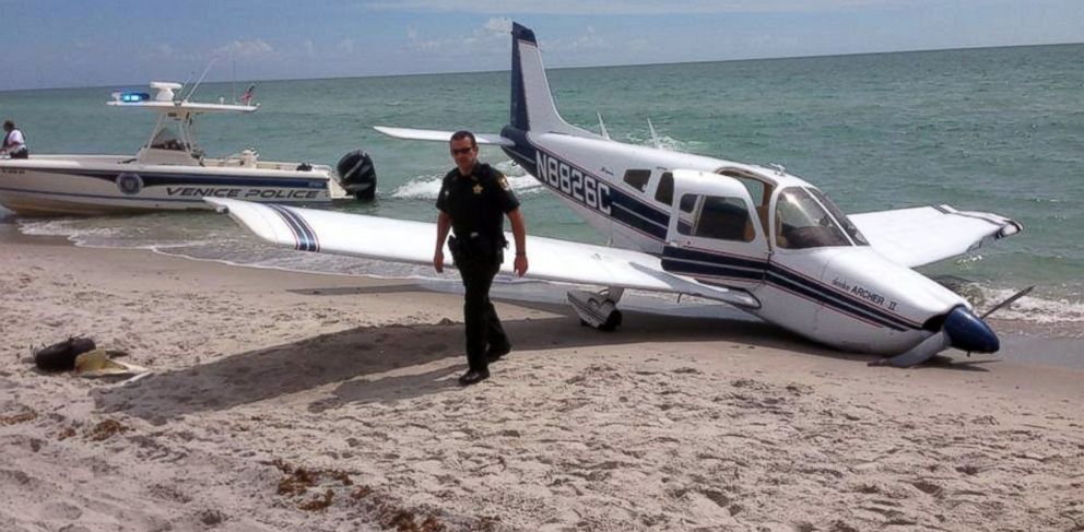 PHOTO: This Sunday, July 27, 2014, photo provided by the Sarasota County Sheriffs Office shows emergency personnel at the scene of a small plane crash in Caspersen Beach in Venice, Fla.