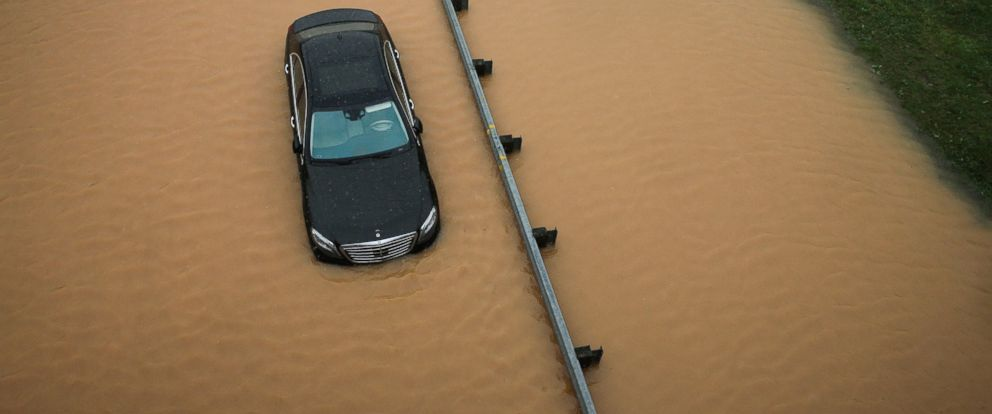 PHOTO: A partially submerged car sits on a flooded section of Interstate 695 in Baltimore, Aug. 12, 2014, after heavy rains fell across the Mid-Atlantic region.