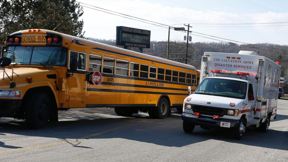 PHOTO: A Salvation Army disaster services vehicle drives past a school bus onto the campus of the Franklin Regional School District where several people were stabbed at Franklin Regional High School, April 9, 2014 in Murrysville, Pa., near Pittsburgh.