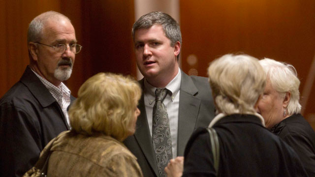 PHOTO: Gabe Watson, center, talks with family members including his father David Watson, left, during a break in his trial at the Mel Bailey Criminal Justice Center in Birmingham, Ala., Feb. 16, 2012.