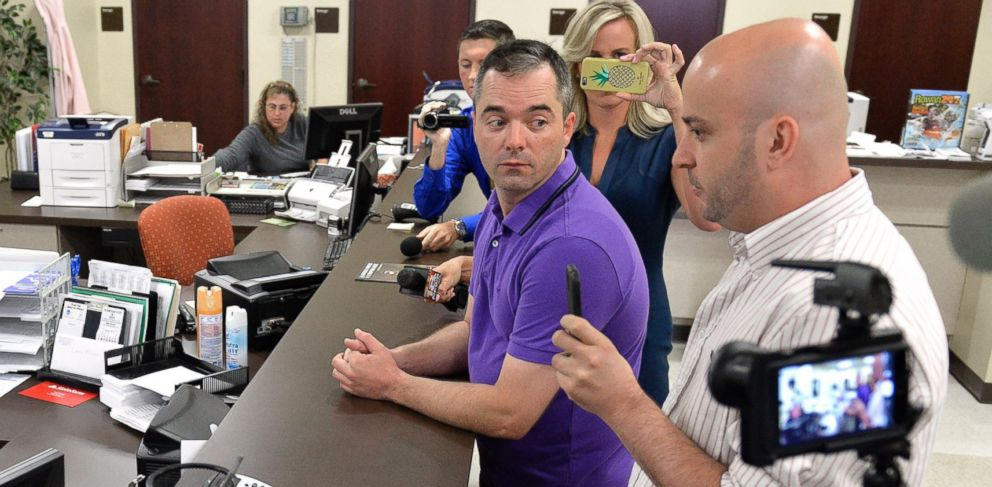PHOTO: William Smith Jr. and his partner James Yates speak with an unnamed clerk in an attempt to obtain a marriage license at the Rowan County Courthouse in Morehead, Ky., Aug. 27, 2015.