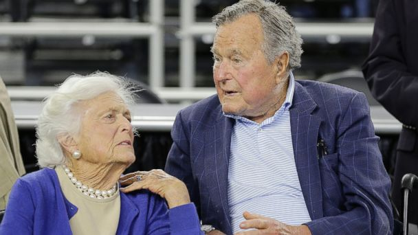 PHOTO: In this March 29, 2015, file photo, former President George H.W. Bush and his wife Barbara Bush speak before a college basketball regional final game between Gonzaga and Duke, in the NCAA basketball tournament in Houston.