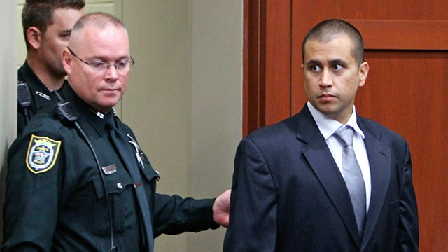 George Zimmerman, right, enters the courtroom, April 20, 2012, during a bond hearing in Sanford