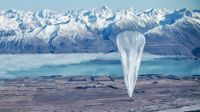 A Google balloon sails through the air with the Southern Alps mountains in the background, in Tekapo, New Zealand, on June 10, 2013.