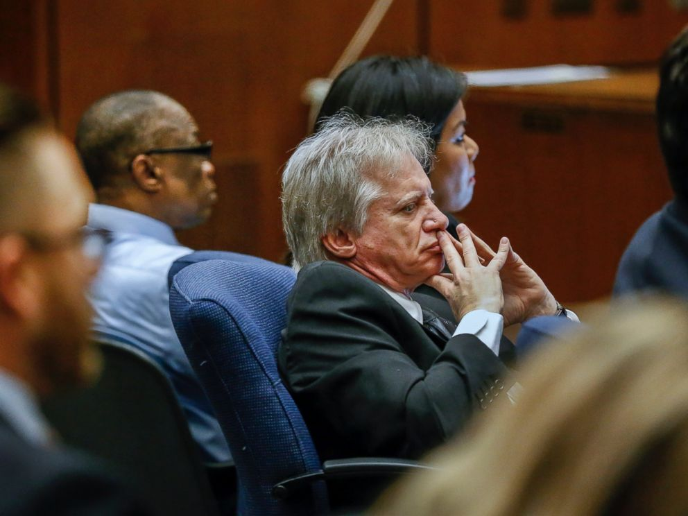 PHOTO: Lonnie Franklin Jr., left rear, appears with his defense attorney Seymour Amster, center, in Los Angeles Superior Court for opening statements in his trial on Feb. 16, 2016.