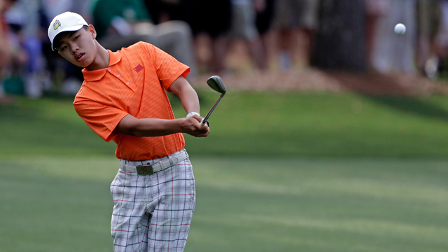 PHOTO: Amateur Guan Tianlang, of China, chips to the first green during the second round of the Masters golf tournament Friday, April 12, 2013