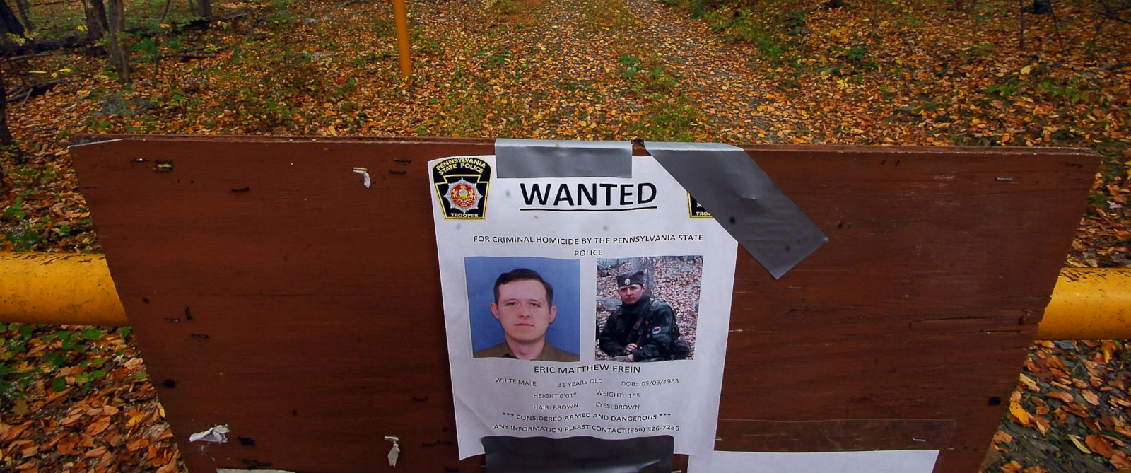PHOTO: A wanted poster of suspected killer Eric Frein is posted at an entrance to a trail in the woods, Oct. 2, 2014, in Barrett Township near Canadensis, Pa.