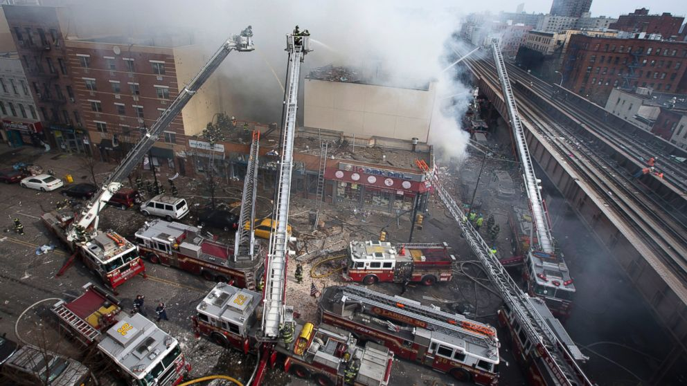 Firefighters battle a fire after a building collapse in the East Harlem neighborhood of New York, March 12, 2014.PHOTO: