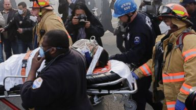 PHOTO: Rescue workers remove an injured person on a stretcher after a possible explosion and building collapse in the East Harlem neighborhood of New York, March 12, 2014.