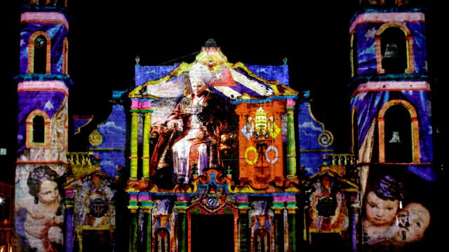 PHOTO: Images of Pope Benedict XVI, by the French-Italian artist Gaspare Di Caro, are projected on the facade of the cathedral in Havana, Cuba on March 25, 2012.