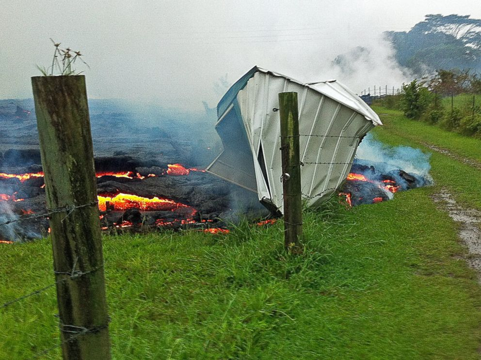 PHOTO: A small shed is consumed by lava in a pasture between the Pahoa cemetery and Apaa Street near the town of Pahoa on the Big Island of Hawaii, Oct. 25, 2014.