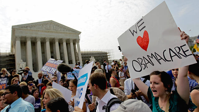 PHOTO: Supporters of President Barack Obamas health care law celebrate outside the Supreme Court in Washington on June 28, 2012, after the courts ruling was announced.