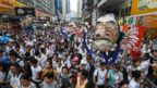 PHOTO: Protesters hold an effigy of Hong Kong Chief Executive Leung Chun-ying as they march during an annual protest in downtown Hong Kong, July 1, 2014.