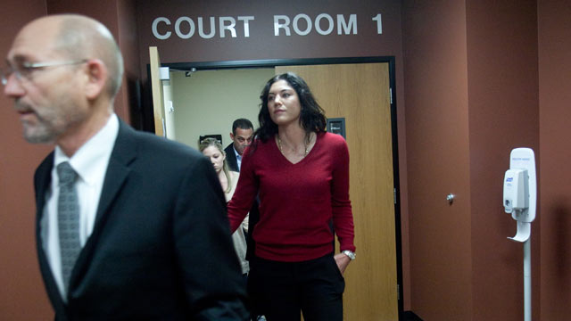 PHOTO: Soccer star Hope Solo leaves a courtroom with her lawyer Peter Offenbecher, left, after a bail hearing for former Seattle Seahawks player Jerramy Stevens in Kirkland, Wash., Nov. 13, 2012.